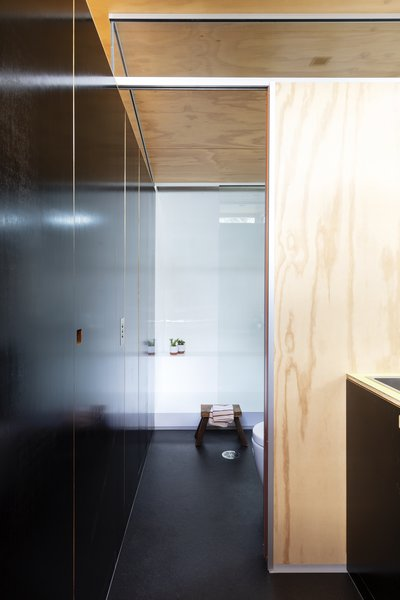 The shower is built into the curve of the structure, maximizing the unique space.
