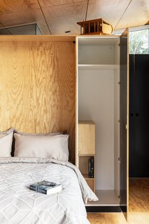 Wardrobe storage flanks either side of the built-in bed.