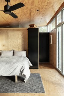 A queen-size Murphy bed folds down from this interior wall, transforming open living space into a bedroom.