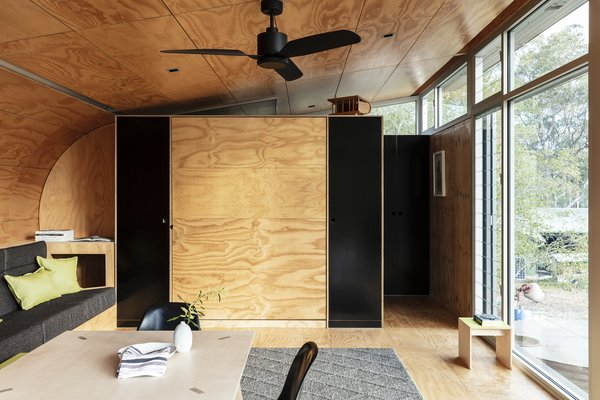 To keep costs low, architect Mark Fullagar fitted this compact cabin with hollow-insulated plywood panels that lend warmth and texture to the interior.