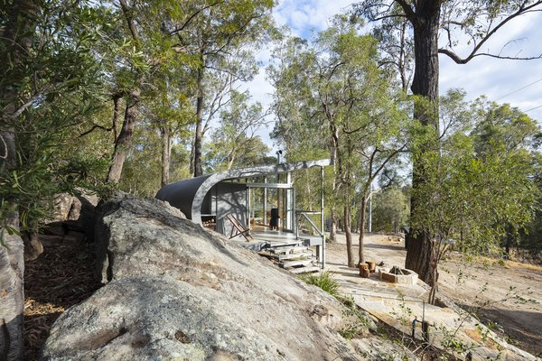 Fabshack is designed to be adaptive to many different site configurations. In this instance, it nestles into a rock outcropping on the architect's property northwest of Sydney.