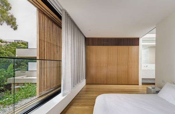Layered elements, including a movable wood screen and interior curtains, provide plenty of options for comfort and privacy.