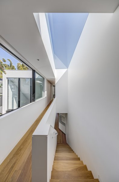 A large skylight mirrors the plan of the stairs, allowing light to fall into the corridors.