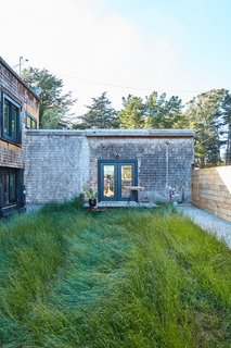 A lush, protected courtyard allows homeowners to enjoy the outdoors but maintain privacy.