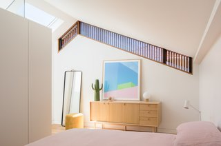In the new master suite, a clerestory window reveals the exterior wood batten screen, which provides both privacy and light.