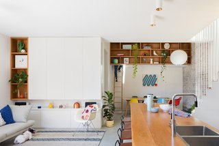 What was once a poorly planned floor plan has transformed into open, brightly lit living spaces at the hub of the home.