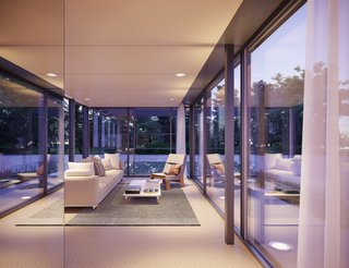 The penthouse is enclosed almost completely in glass.
