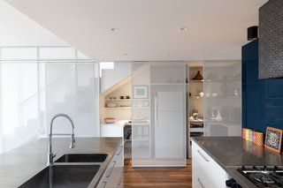 Sliding screens reveal additional kitchen prep and storage space.