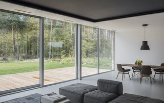 Large sliding glass doors open the main living spaces to the landscape.