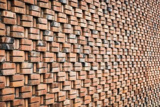 The steady rhythm and pattern of the brick creates a quilt-like facade.