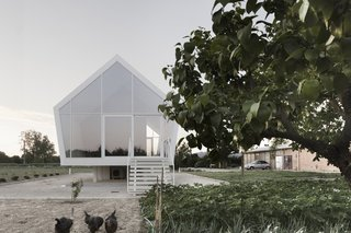 Although innovative in construction, the simple and pure gabled form relates to the character of the rural setting and the agrarian use of the building. Elevated slightly above the ground, the home inflicts minimal intrusion on the existing landscape.