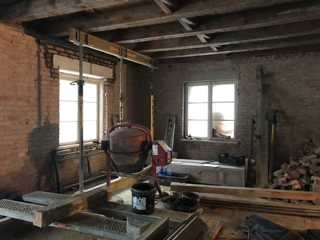Before: Due to the age of the building, the structure had to be strengthened and checked for soundness as part of the renovation process.  Photo 4 of 20 in This Renewed 1920s Home in Poland Is Stunning in its Simplicity