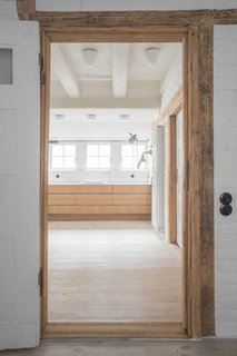 Timber elements frame openings, including the entrance to the master bath on the first level.