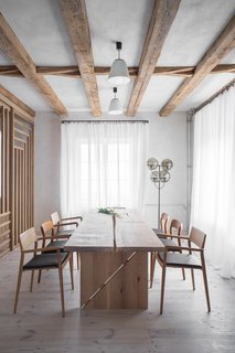 Throughout the home, furniture is mostly made of natural, oiled oak wood.