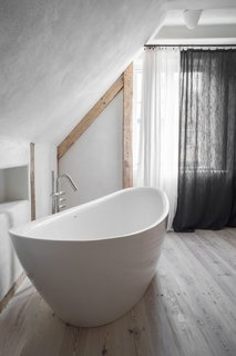 The bath is a serene, relaxing retreat complete with a soaking tub.