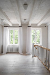 The first floor is calm and serene with the same muted color palette that fills the ground floor.