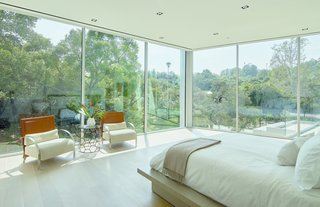 With floor-to-ceiling glass, the master bedroom has uninterrupted views of the surrounding vistas and rolling hills.