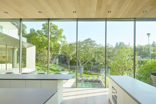 The kitchen is the focal point of the home, with views to the rest of the house and the surrounding grounds.