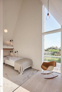 A bunk room is the perfect space for kids to enjoy this Nordic retreat.