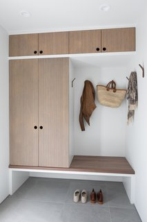 By reconfiguring the main areas, the designer was able to incorporate a mudroom area with custom bamboo built-ins.
