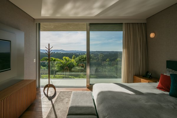 Located on the upper floor, stacked above the main living spaces, each sleeping room has its own exquisite views of the surrounding hills.