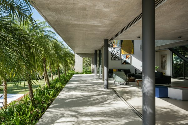 The large overhang creates an outdoor porch that becomes an extension of the living spaces.