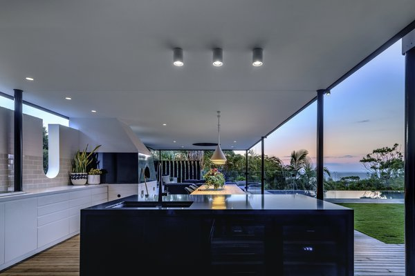 A sleek, simple kitchen area is unobtrusive to the 180-degree views.