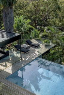 The infinity pool reaches out above the hillside with stunning views of Australia's Northern Beaches.