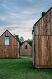 The simple structures are a modern play on the traditional cabin with wood-clad exteriors and gabled roofs.
