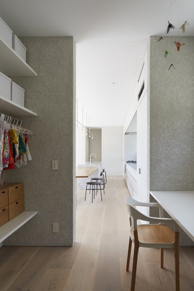 A nursery lies adjacent to the kitchen in the northeast corner of the plan. Complete with built-in storage and a desk area, the nursery doubles as a playroom for kids.