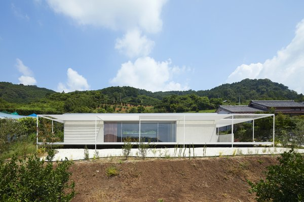 A Shaded Veranda Wraps Around This Japanese Dwelling