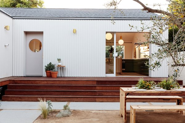 Annie Ritz and Daniel Rabin, the couple and co-founders behind And And And Studio, revamped a neglected home in the Silverlake neighborhood of Los Angeles by adding a tall re-framed roof and 1,000-square-foot extension, as well as emphasizing outdoor areas like the wood deck adjacent to the pool. Interior highlight: the kitchen, with its olive green cabinetry and wood-clad circular island.