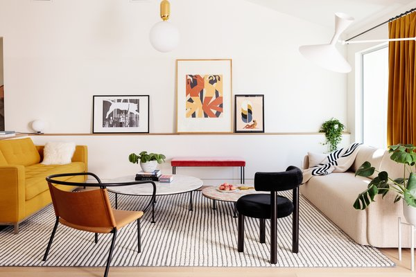 The living room is a blend of old and new, simple and bold, playful and sophisticated with Muuto, Tom Dixon, and repurposed Maharam furniture.