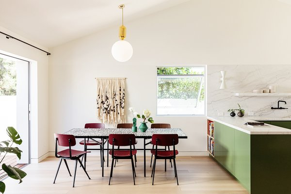 The dining table is a custom piece with a terrazzo top on a steel base.  Burgundy Result Chairs from Hay add a rich color accent to the dining room.