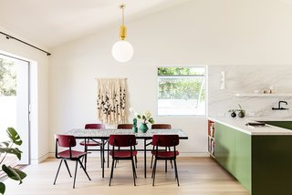 Fiber art brings an element of softness to this dining area.