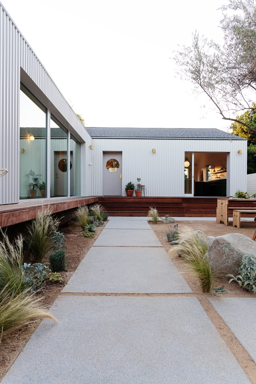 Courtyard House by And And And Studio concrete pavers in the courtyard