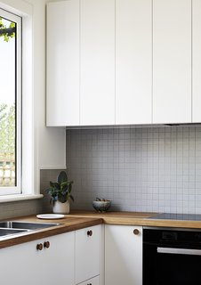 Simple joinery introduces contemporary details into the revamped kitchen space.