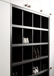 Built-in shoe cubbies provide necessary storage in the new walk-through laundry space.
