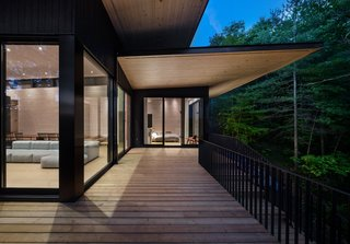 Large overhangs shelter the home from the summer sun, while allowing daylight to warm the interiors in the winter.