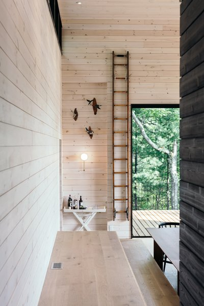 The client specifically requested that the architects not use drywall anywhere—thus whitewashed pine serves as the project's primary material.