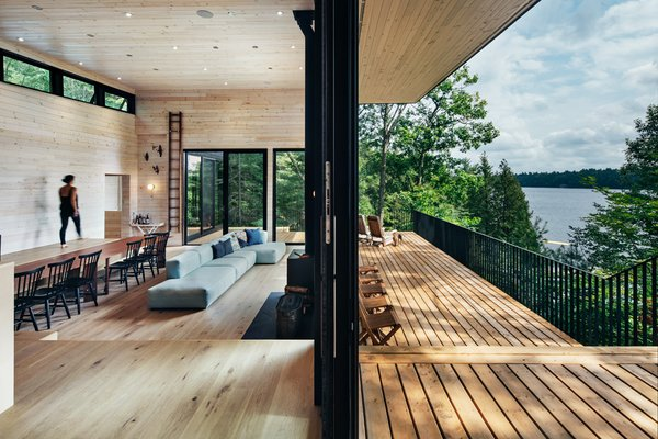 In the public spaces, large sliding glass doors provide a seamless connection for indoor/outdoor living.