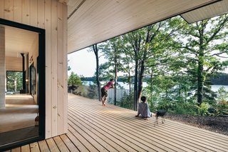 The large, covered deck increases the amount of livable space while providing views of the lake and the hillside terrain.