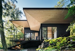The large overhangs provide year-round comfort while adding a strong architectural element to the simple massing.