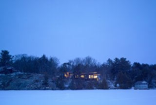 The Lake Joseph Cottage sits amidst historic single-story Victorians and new three- to four-story McCottages.