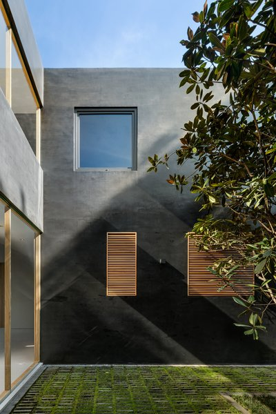 Windows provide framed views to the courtyards from both walkways and living spaces.
