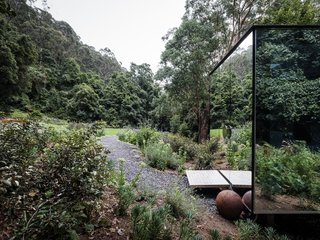 The surrounding landscape was subtly modified to create a path to the bathroom, and to hide the columns on which the structure sits.