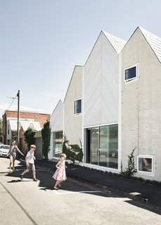 The house directly engages with the street through direct access, large openings, and windows.