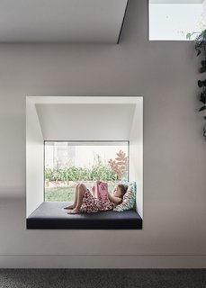 Special moments are integrated throughout the home which provide function for both the parents and kids. Here, a deep window doubles as a reading nook.