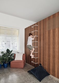 "The ""rumpus"" and craft rooms hide a range of secrets—pin-boards, blackboards, sliding doors, cubby holes, and toy storage. A ladder in the study leads to extra storage space or a place for the kids to hide."