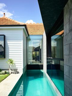 The lap pool provides a focal point both inside and outside. Connecting old and new, as well as public and private, the lap pool links all spaces at the heart of the home.